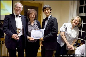 Sam presents Ann and John with the Vic Treen Trophy