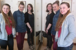 Megan, Ella and Alice with their stunt doubles