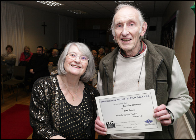 Brenda presents John with Top Ten Runner Up certificate