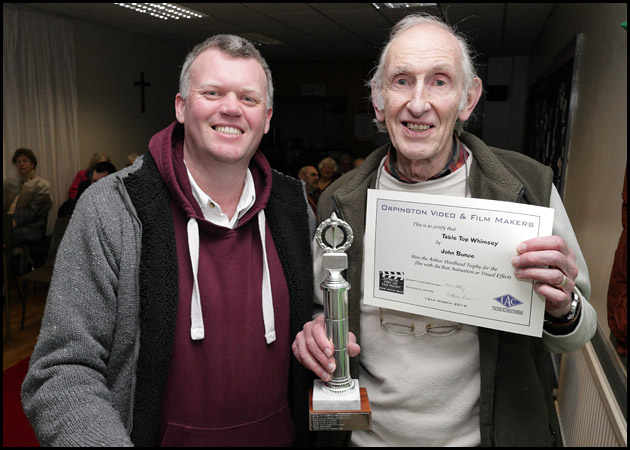 Craig presents John with the Arthur Woolhead Trophy