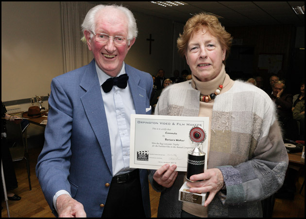 Barbara receives the Reg Lancaster Trophy from Reg himself